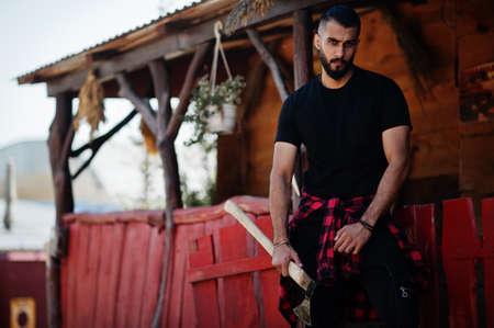 Arab hipster beard man lumberjack hold ax. Standard-Bild