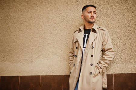 Stylish kuwaiti man at trench coat.