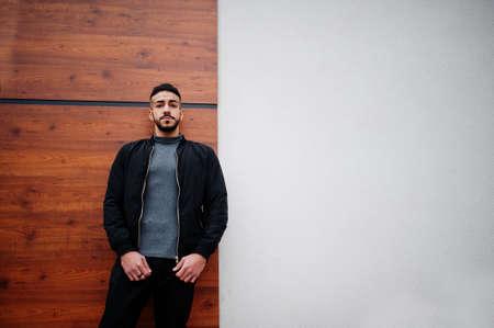 Portrait of stylish arab beard man wear gray turtleneck and black jaket. Arabian model guy.