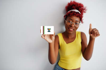 African woman with afro hair hold Lagos flag isolated on white background, show thumb up. States of Nigeria concept.