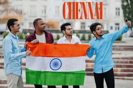 Chennai city inscription. Group of four indian male friends with India flag making selfie on mobile phone. Largest India cities concept. Stock Photo