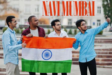 Navi Mumbai city inscription. Group of four indian male friends with India flag making selfie on mobile phone. Largest India cities concept.