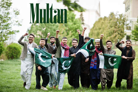 Multan city. Group of pakistani man wearing traditional clothes with national flags. Biggest cities of Pakistan concept.