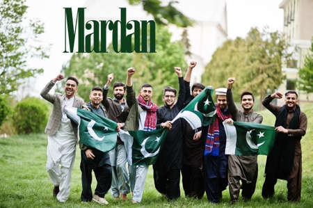 Mardan city. Group of pakistani man wearing traditional clothes with national flags. Biggest cities of Pakistan concept.