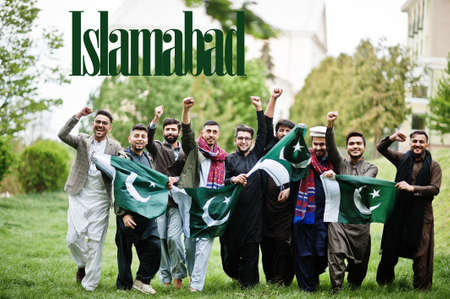 Islamabad city. Group of pakistani man wearing traditional clothes with national flags. Biggest cities of Pakistan concept.
