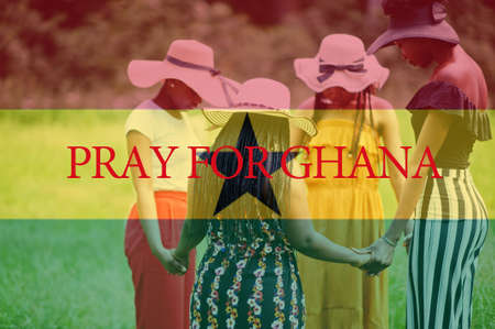 Pray for Ghana. Group of four african women holding hands and praying. Concept of crisis in Africa country.