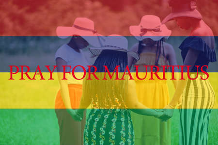 Pray for Mauritius. Group of four african women holding hands and praying. Concept of crisis in Africa country.