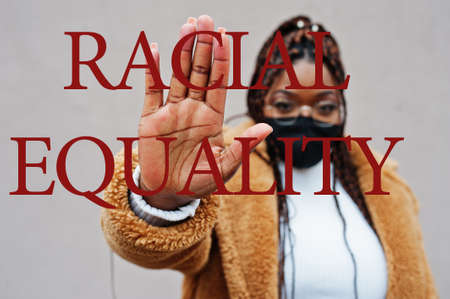 Racial equality. African american woman, wear black face mask show stop hand sign.