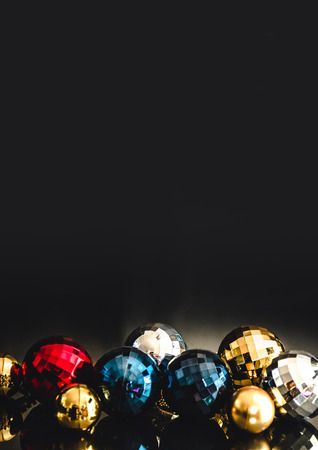 Colorful christmas baubles motive. Decorations for cards, backgrounds. Yellow, red, blue and silver balls. Stock Photo