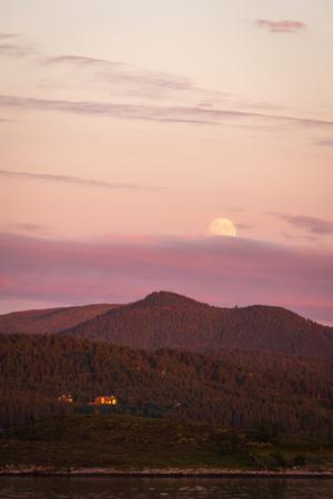 Moon rise and fantastic sunset time. Lesundøya island, western coast of Norway.