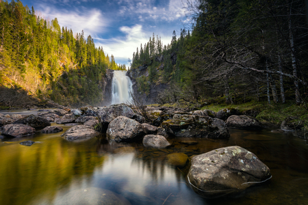 Storfossen waterfall in boreal forest. Homla river, Norwegian outdoors, summer time. Imagens