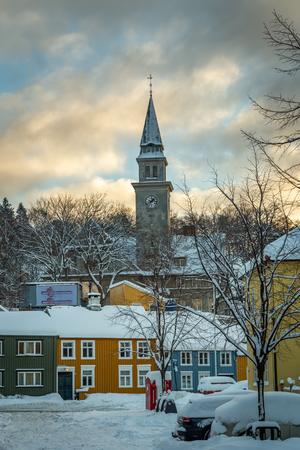 Baklandet street under snow. Wintertime in Trondheim, Norway. Colorful town buildings, original old town look. Stok Fotoğraf