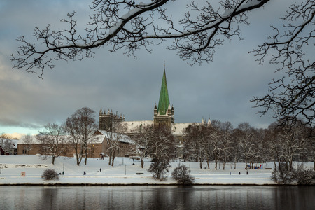 Nidarosdomen Cathedral by Nidelva river in Trondheim. Beautiful wintertime. Most famous gothic, norwegian church.