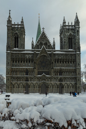 Nidarosdomen Cathedral by Nidelva river in Trondheim. Beautiful wintertime. Most famous gothic, norwegian church. Frontal look.