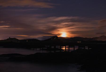 Rising moon over Atlantic Ocean Road - Atlanterhavsveien, in Norway. Winter night over this famous road.