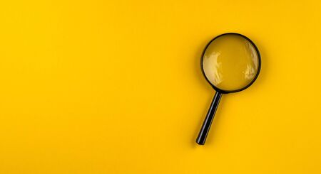 magnifying glass on yellow background