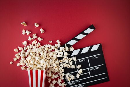 Movie clapper board and popcorn
