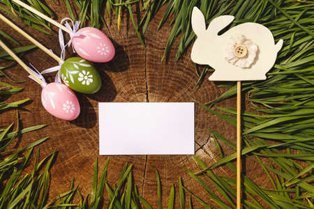 backgroung: Happy easter artificial eags on wooden backgroung Stock Photo