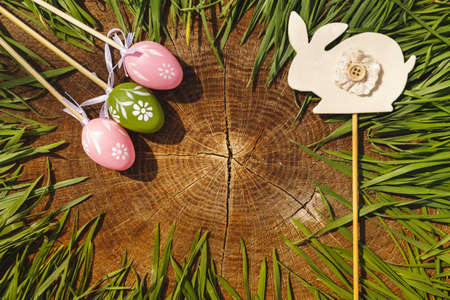 Happy easter artificial eags on wooden backgroung photo