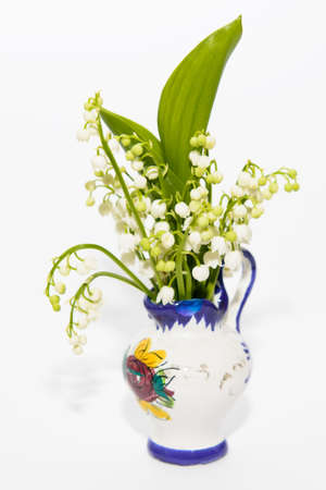 majalis: Lilies of the valley in small vase