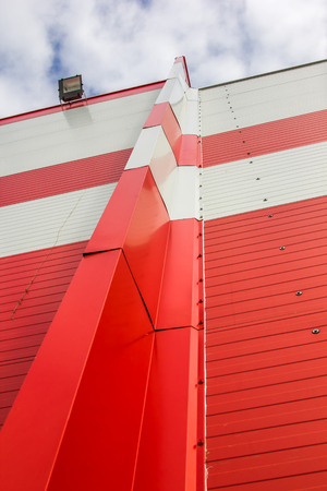Made of red and white sandwich panels. Visible structure of the seam between the panels.