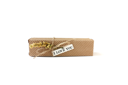 gist: Gist box with string flower and note I love you. Box is made from environmentally friendly carton. Stock Photo