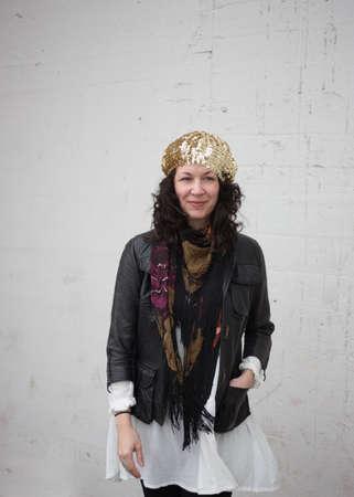 thirtysomething: Caucasian woman wearing cool weather bohemian style fashion, white background wall