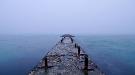 lonelyness: Breakwater in the sea Stock Photo