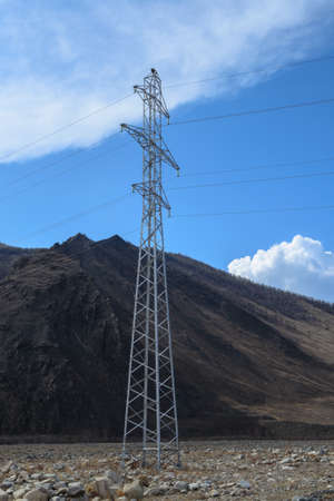 electric wires: A high voltage transmission tower with electric wires