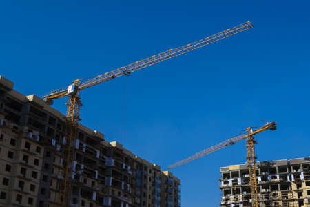 constraction: New buildings and constraction craines on blue sky background.