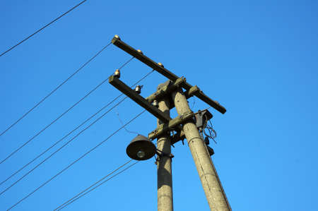 Old   pylon with electric lines