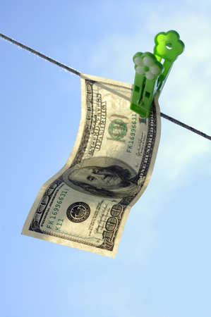 concept - fair business, a dollar banknote hangs on a cord Stock Photo - 13745857