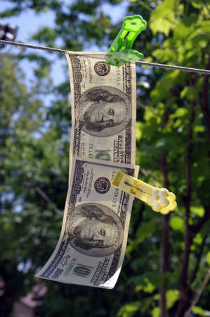 concept - fair business, a dollar banknote hangs on a cord Stock Photo - 13745855