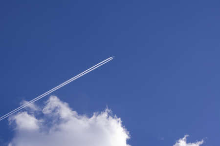 jet plane flying highly in the   blue sky