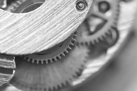 Black and white background with metal cogwheels a clockwork. Conceptual photo for your successful business design. Macro Stock Photo