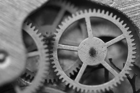 Black and white background with metal cogwheels inside clockwork. Conceptual photo for your successful business design. Macro. Stock Photo