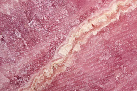 halide: Rhodochrosite MNCO3. Pink manganese carbonate mineral. Macro. Beautiful fantastic background  for successful business projects and other Your variant.