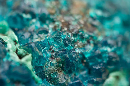 halide: Chrysocolla is a hydrated copper cyclosilicate It has the chemical formula (Cu,Al)2H2Si2O5(OH)4nH2O.Cyan (blue-green) crystal. Macro. Beautiful fantastic background for successful business projects and other Your variant Stock Photo