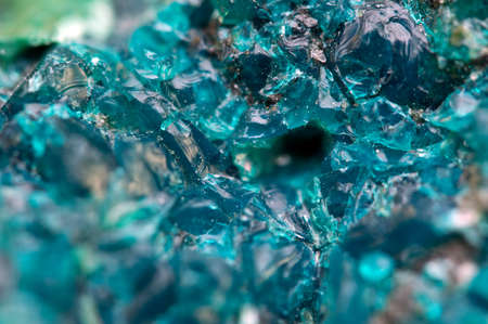 Chrysocolla is a hydrated copper cyclosilicate It has the chemical formula (Cu,Al)2H2Si2O5(OH)4nH2O.Cyan (blue-green) crystal. Macro. Beautiful fantastic background for successful business projects and other Your variant Standard-Bild