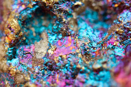 Bornite, also known as peacock ore, is a sulfide mineral with chemical composition Cu5FeS4 that crystallizes in the orthorhombic system (pseudo-cubic). Macro. Beautiful fantastic background for successful business projects and other Your variant. Stockfoto