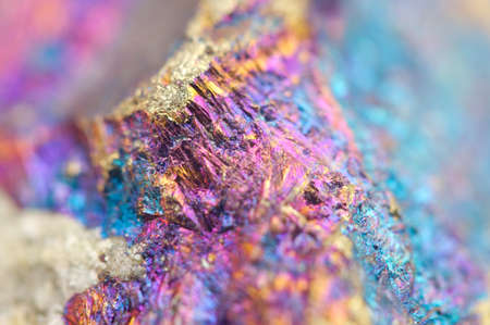 sulfide: Bornite, also known as peacock ore, is a sulfide mineral with chemical composition Cu5FeS4 that crystallizes in the orthorhombic system (pseudo-cubic). Macro. Beautiful fantastic background for successful business projects and other Your variant. Stock Photo