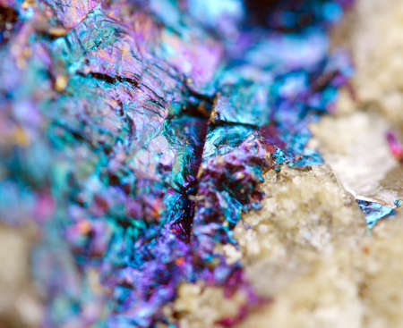 halide: Bornite, also known as peacock ore, is a sulfide mineral with chemical composition Cu5FeS4 that crystallizes in the orthorhombic system (pseudo-cubic). Macro. Beautiful fantastic background for successful business projects and other Your variant. Stock Photo