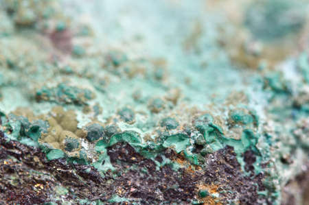 hydroxide: Malachite is a copper carbonate hydroxide mineral, with the formula Cu2CO3(OH)2. Green banded mineral crystallizes in the monoclinic crystal system. Macro. Stock Photo