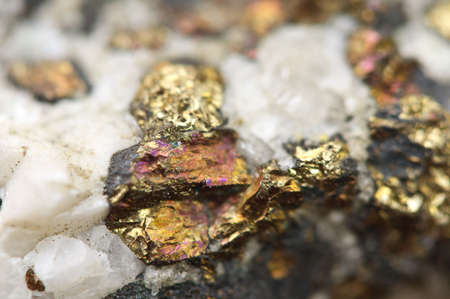 halide: Chalcopyrite, It has the chemical formula (CuFeS2). Copper iron sulfide mineral. Macro. Beautiful fantastic background for successful business projects.