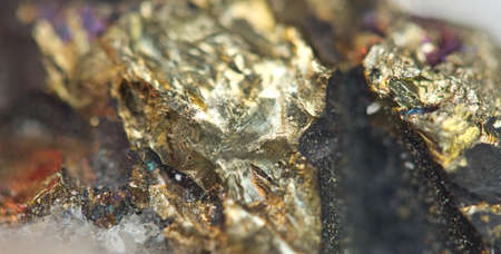 halide: Chalcopyrite, It has the chemical formula (CuFeS2). Copper iron sulfide mineral. Macro. Beautiful fantastic background for successful projects.