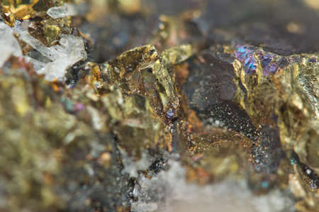 sulfide: Chalcopyrite, It has the chemical formula (CuFeS2). Copper iron sulfide mineral. Macro. Beautiful fantastic background for successful projects.