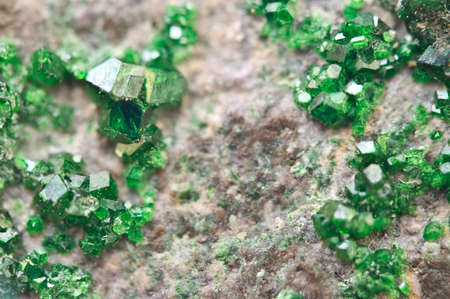Uvarovite is a chromium-bearing garnet group species with the formula: Ca3Cr2(SiO4)3. Macro. Background for successful Your projects Stock Photo