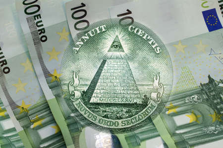 eye of providence: Element of the image of United States one-dollar bill, pyramid, Eye of Providence above one hundred euros banknotes. Conceptual photo for your successful business design. Macro
