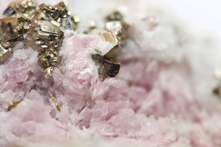halide: Rhodochrosite is a manganese carbonate mineral with chemical composition MnCO3 with iron pyrite FeS2 Macro Stock Photo