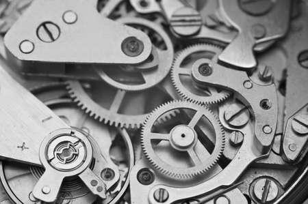 macro: Black and white macro photo close-up view of metal clockwork. Concept eternity, teamwork